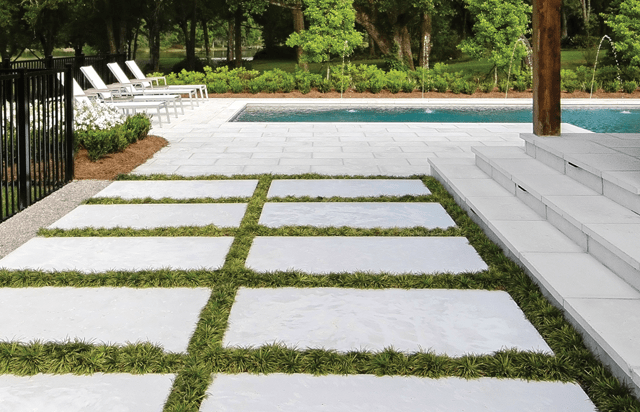 Concrete paver pool patio with grassy joints